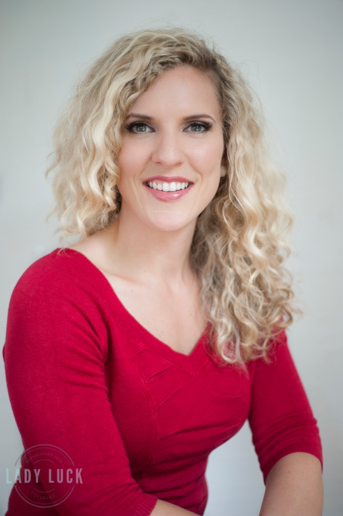 corporate-head-shots-for-mortgage-broker-edmonton-alberta-blonde-female-wearing-red-sweater-smiling-at-the-camera