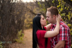 outdoor-couples-portraits-at-the-royal-alberta-museum-couple-holding-eachother-and-about-to-kiss