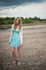 glamour-session-of-woman-standing-near-the-river-in-edmonton-on-a-rocky-beach