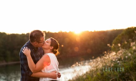 engagement-portraits-in-edmonton-alberta-by-the-river-sunset-in-the-background