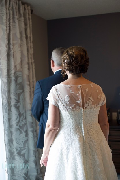 briding-walking-up-to-the-groom-for-a-first-look