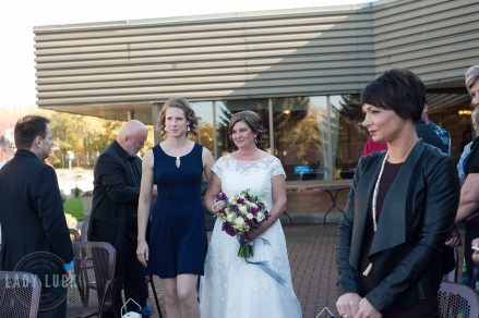 bride-walks-down-the-isle-with-daighter