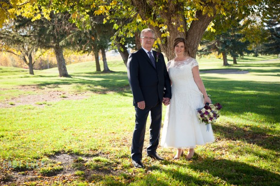 bride-and-groom-holding-hands-under-a-tree