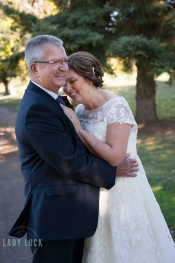 bride-nuzzling-into-the-grooms-neck