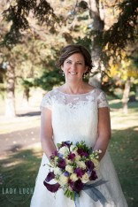 the-bride-holding-her-bouquet-smiling-at-the-camera